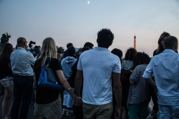 Just a couple people lining the Seine waiting for the fireworks to start.